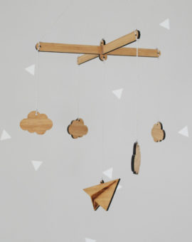 Wooden mobile, paper airplane